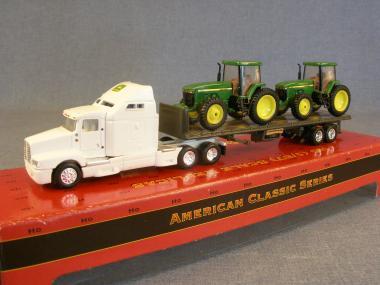 KENWORTH T600B mit Pritschenauflieger & JOHN DEERE Traktor 8300 als Ladung