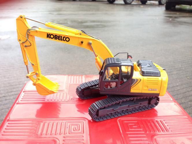 KOBELCO Bagger SK210LC-10, gelb (Amerika)